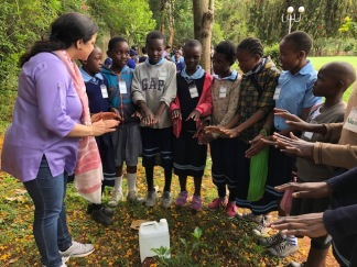 blessing the newly planted tree with Reiki