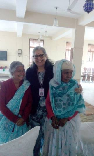Flanked by a Hindu and a Muslim widow at Ma Dham